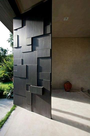 diseños de puertas de metal para casas doble altura