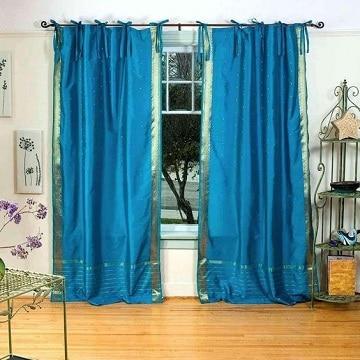 Hermosos ambientes con el uso de cortinas azul turquesa for Cortinas azul turquesa