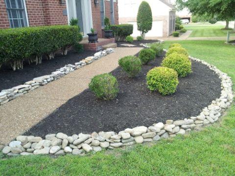 decoracion jardines con piedras grandes adornos