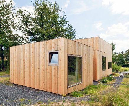 fachadas de casas de madera pequeñas