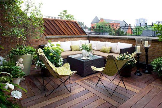 decoracion de terrazas exteriores con plantas y sillones