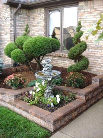 jardines pequeños para frentes de casas fuentes y esculturas