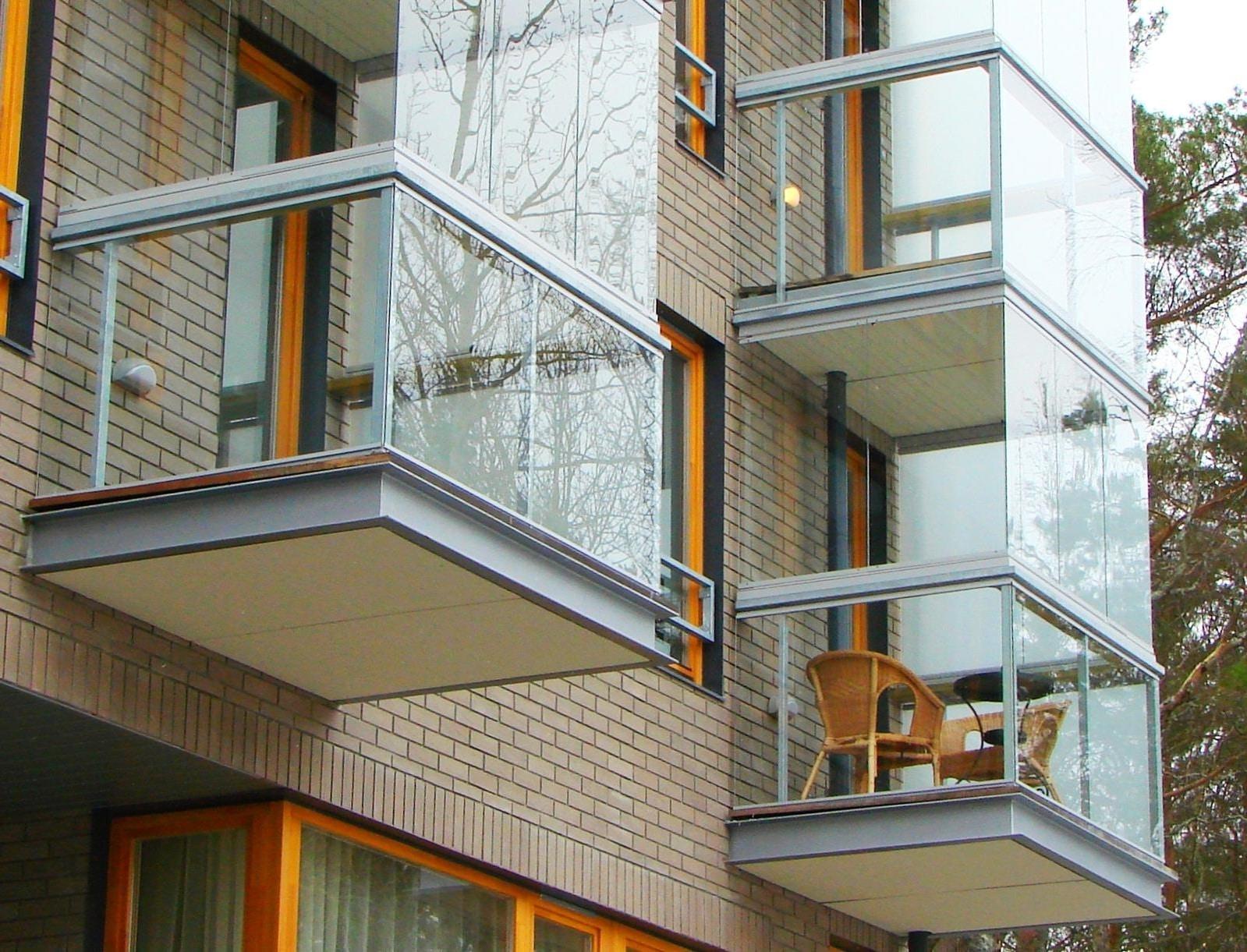 balcones modernos de concreto con cristal