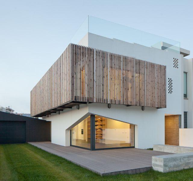 casas con ventanas de madera en casas modernas