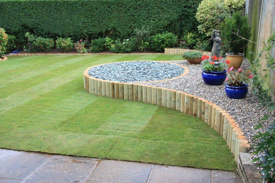 ideas de jardines con piedras macetones